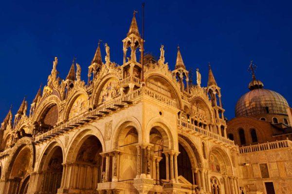 Basilica-di-San-Marco-illuminated-at-night-on-Piazza-San-Marco