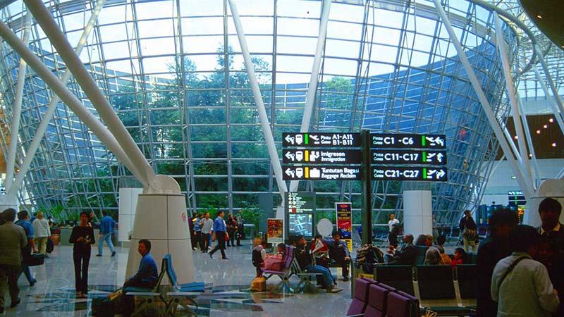 kul kuala lumpur international airport with tropical rainforest