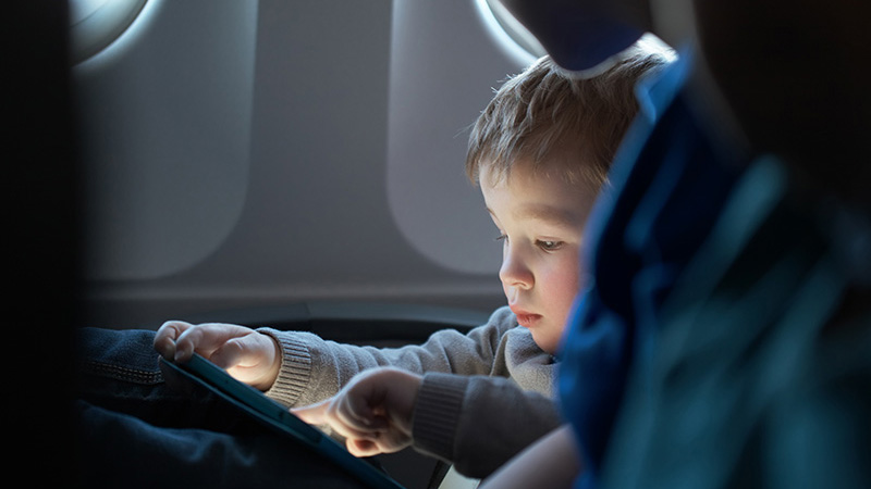 Little boy traveling in an airplane