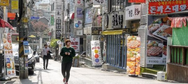 woman-walking-through-seoul