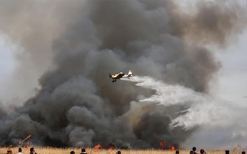 مهار آتش با هواپیماهای آب پاش در تالاب میقان