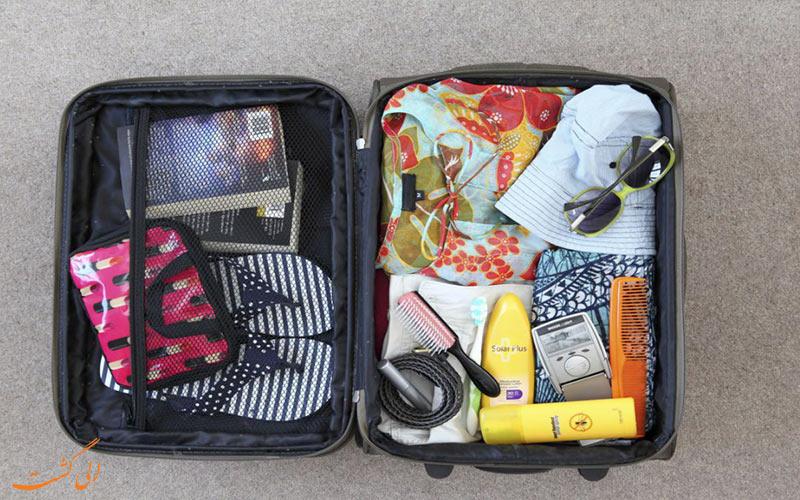 نحوه بستن چمدان برای سفری راحت تر- نحوه بستن چمدان