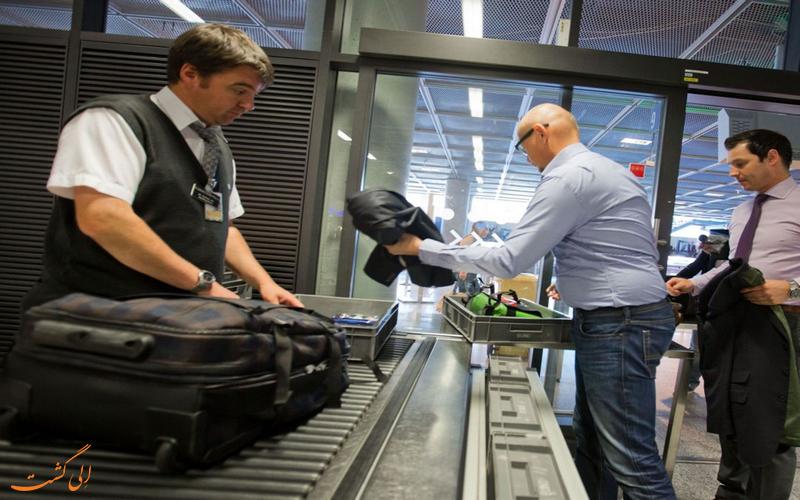 بازرسی امنیتی چمدان در فرودگاه