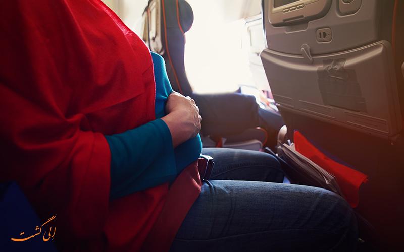 خانم باردار در هواپیما